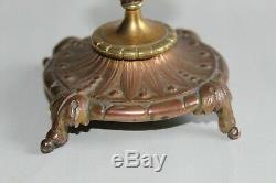 Belle paire de bougeoirs d'autel 19 ème en bronze doré, fleurs, têtes de bélier
