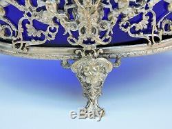 Coupe Napoléon III centre de table verre bleu moulé pied bronze argenté chérubin