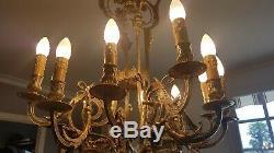 Lustre en bronze doré 12 feux décor de mascarons époque Napoléon III. XIXe