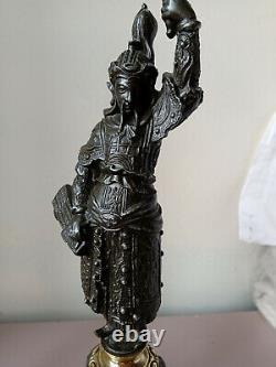 Paire d'exceptionnels anciens chandeliers en régule et bronze