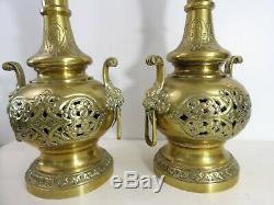 Paire de lampes anciennes bronze ajouré Têtes de lion XIXe Empire Napoleon 3
