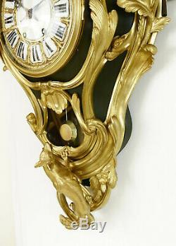 Spectaculaire pendule cartel en bronze doré. Style Louis XV, époque Napoléon III
